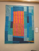 """ISAIAH 58. The words of Isaiah 58, along with so many others in the Bible, clearly illustrate God's concern for the poor and needy, and His longing for us to participate with Him in helping 'the least of these.' Machine quilted. 39""""x54"""". Private collection."""