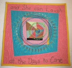 """LAUGHING WOMAN. Of course this is a phrase from the well-know Proverbs 31 woman. It is a combination of the housetop style along with extensive hand embroidery. Finished with machine quilting. 14""""x13"""". SOLD"""