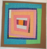 """PSALM 19. A typical housetop style quilt, with the beautiful words of Psalm 19 inscribed on top of it. Machine quilted. 31""""x31"""". $195.00"""