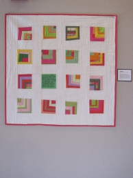 """CONFIDENCE. Often on Sunday mornings during the service, I run across verses that particularly inspire me and lift me up. What a wonderful thought this verse is, that we can face God with confidence because we live like Jesus here in this world. The scripture is found in I John 4:16-17. Machine quilted with words hand embroidered. 34""""x35"""". Private collection."""