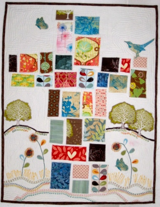 """THE CROSS. Not the Housetop style, and I believe this is the only quilt that uses prints, and it is the only quilt without words. But again, it speaks clearly without words, as it is 'The Signature of Jesus.' Machine quilted with raw edge appliqué, finished with hand embroidered embellishment. 24""""x32"""". Private collection."""